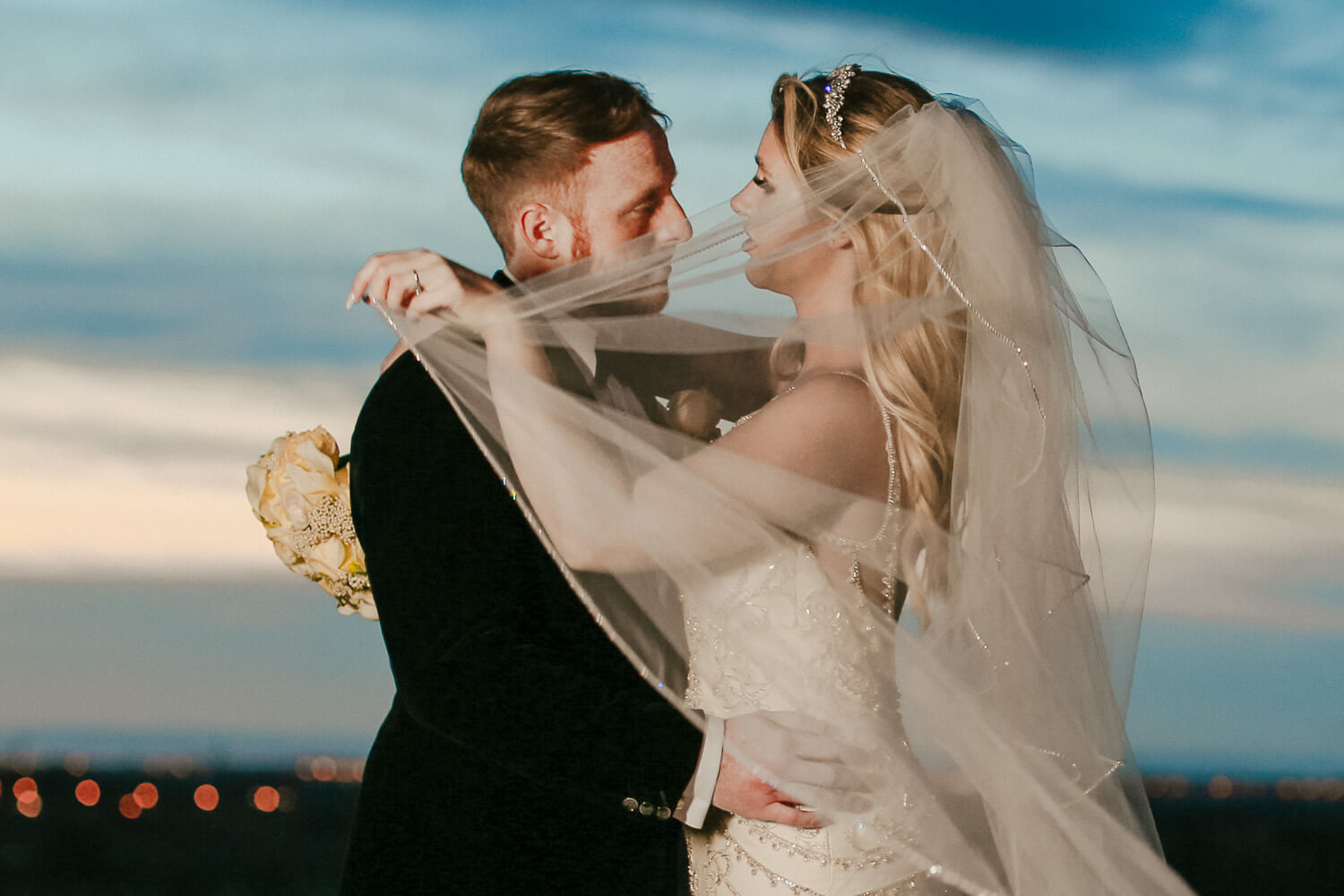 Portrait of bride and groom at sunset West Tower winter wedding