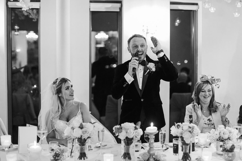 Groom making speech at West Tower winter wedding