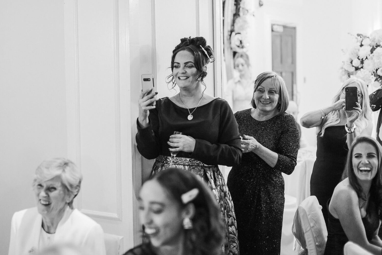Wedding guests filming speeches