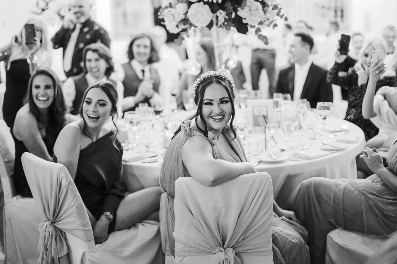 Happy wedding guest watching speeches