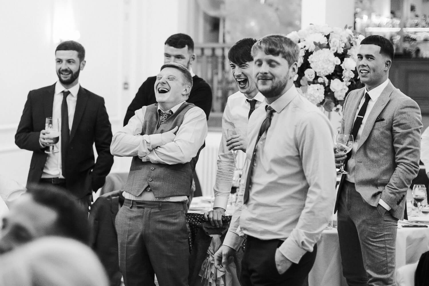 lads laughing at wedding