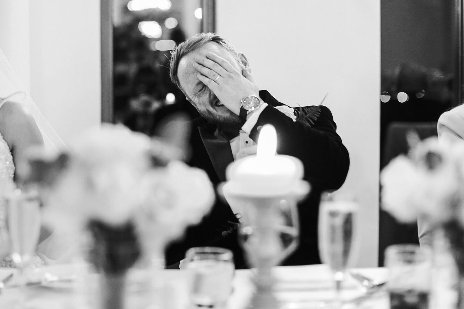 Embarrassed groom with hand on face