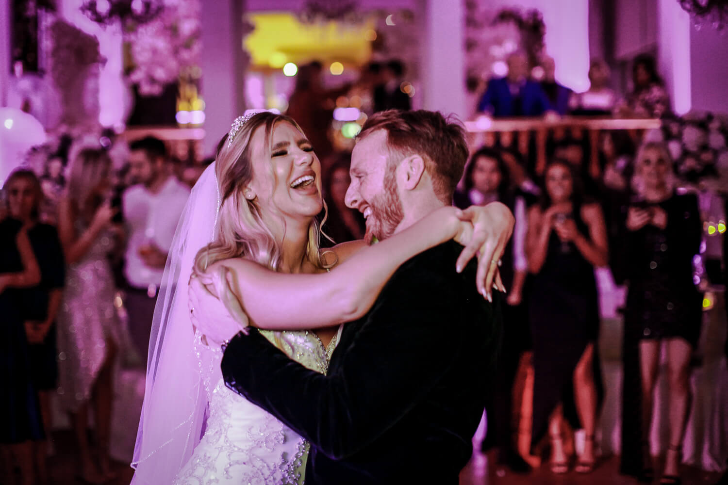 happy laughing bride and groom dancing