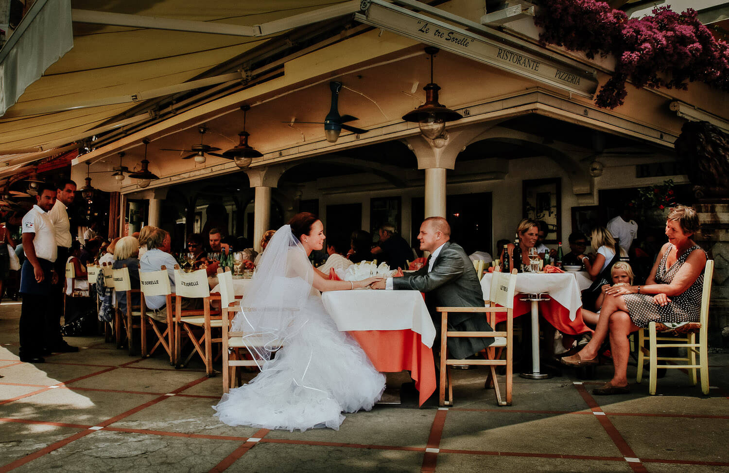 Bride and groom a Positano cafe on wedding day