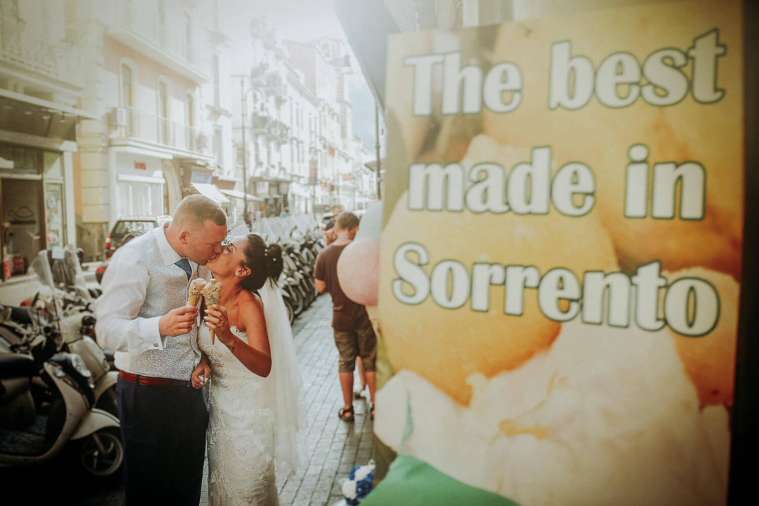 Bride and groom eating ice cream on streets of Sorrento. Best wedding destinations in Europe