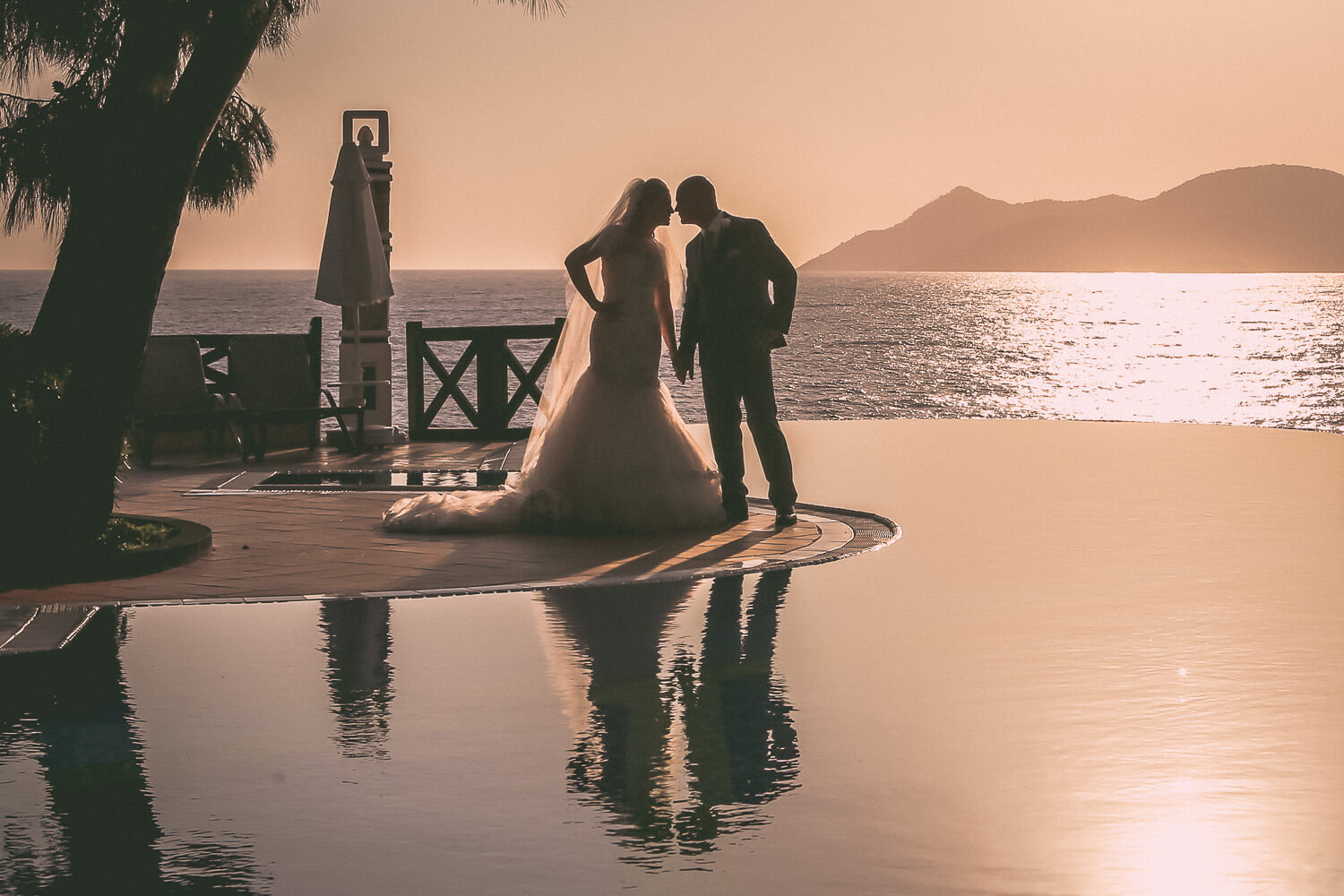 beautiful sunset picture of bride and groom Liberty Lykia hotels Olu Deniz Turkey. Amazing wedding destination in Europe