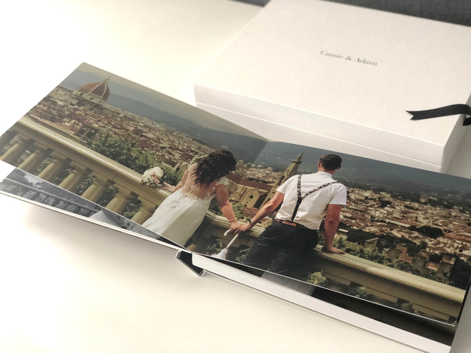 Inside open pages of storybook wedding album could in Florence Italy
