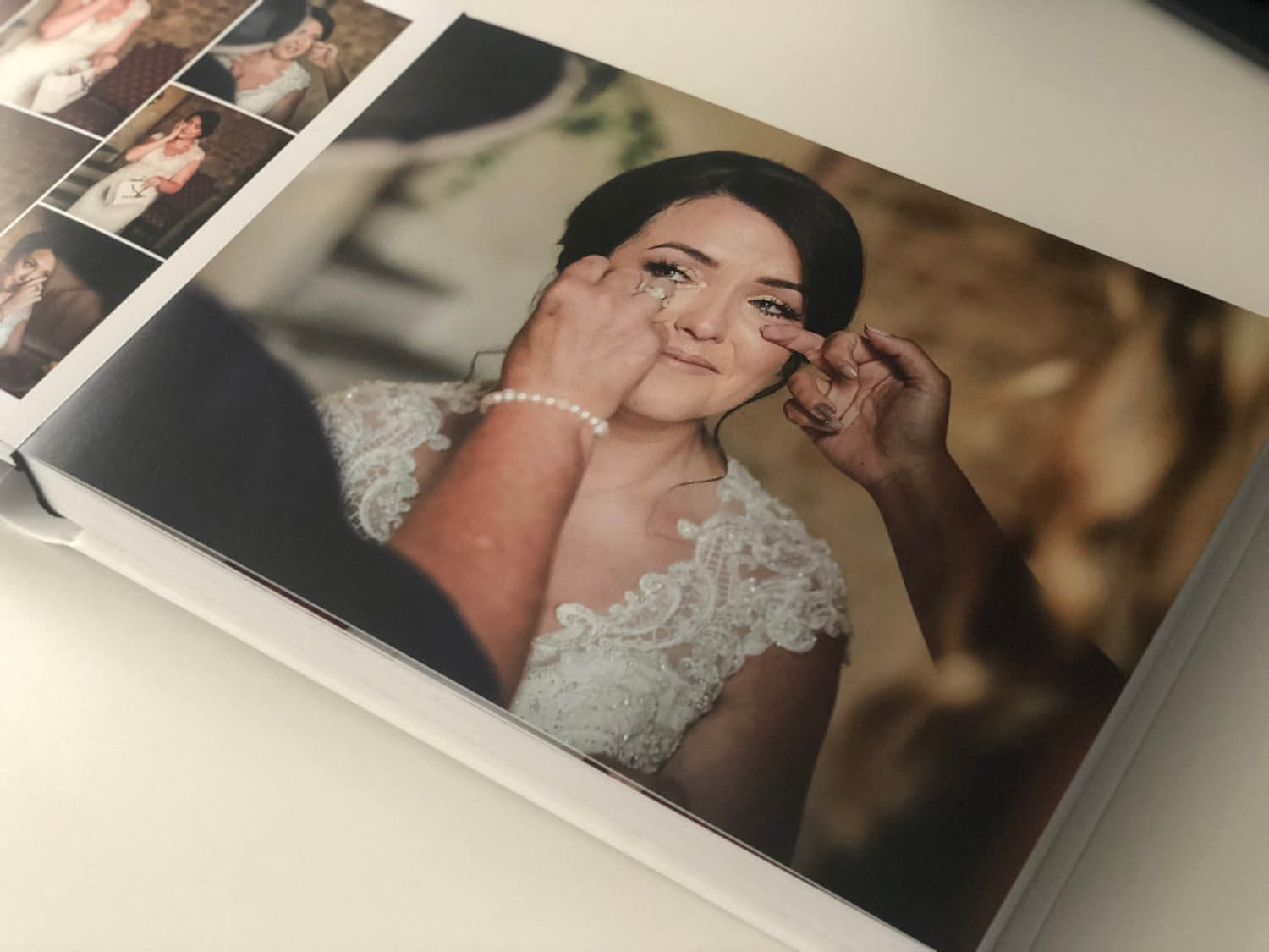 Inside pages of storybook wedding album bride crying