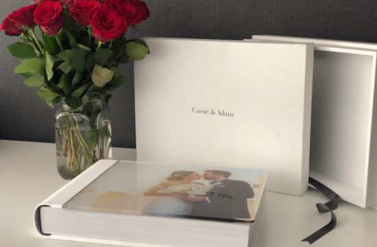 white leather storybook album with glass front cover and red roses Wes Simpson Wedding Photographer Liverpool