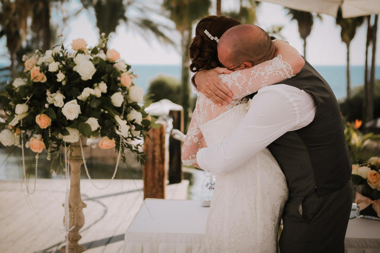 Emotional groom hugging bride Annabelle Hotel wedding Cyprus
