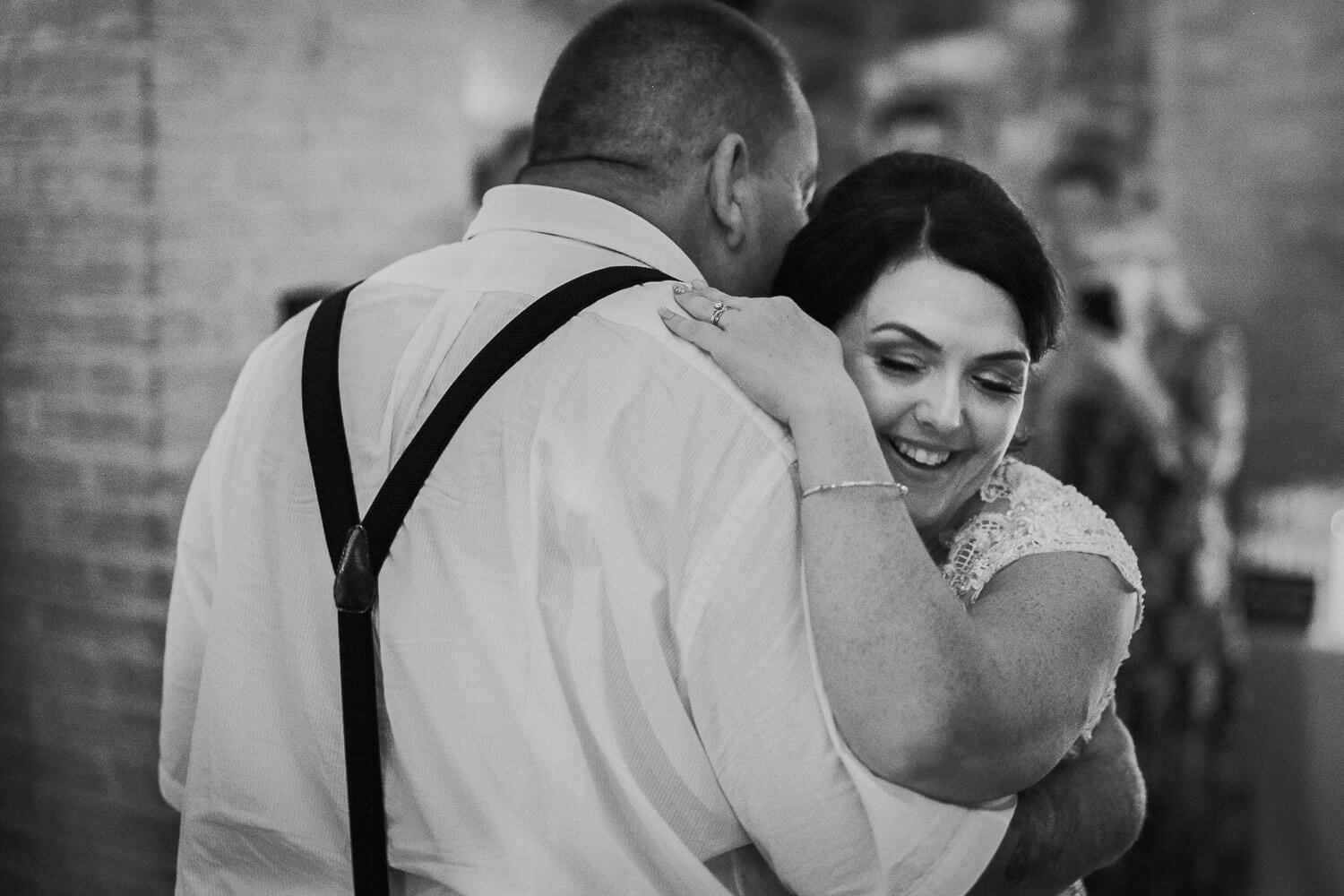 Bride dancing with her father in Tuscany wedding Castello di Bibbione