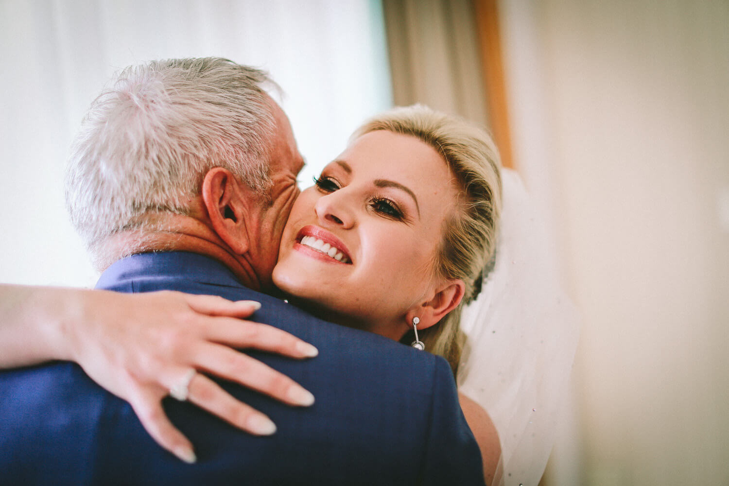 Daughter hugging her father on wedding day Liberty Hotels Lykia