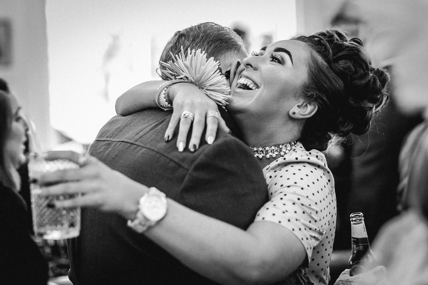 Woman laughing and hugging a man Ashfield House wedding