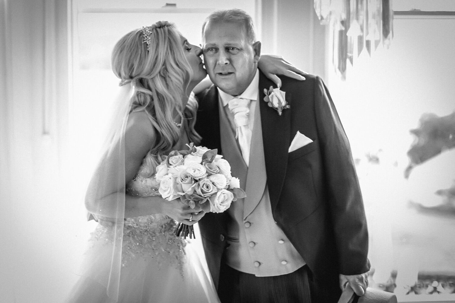 Bride kissing crying dad Laura Ashley Hotel Lake District