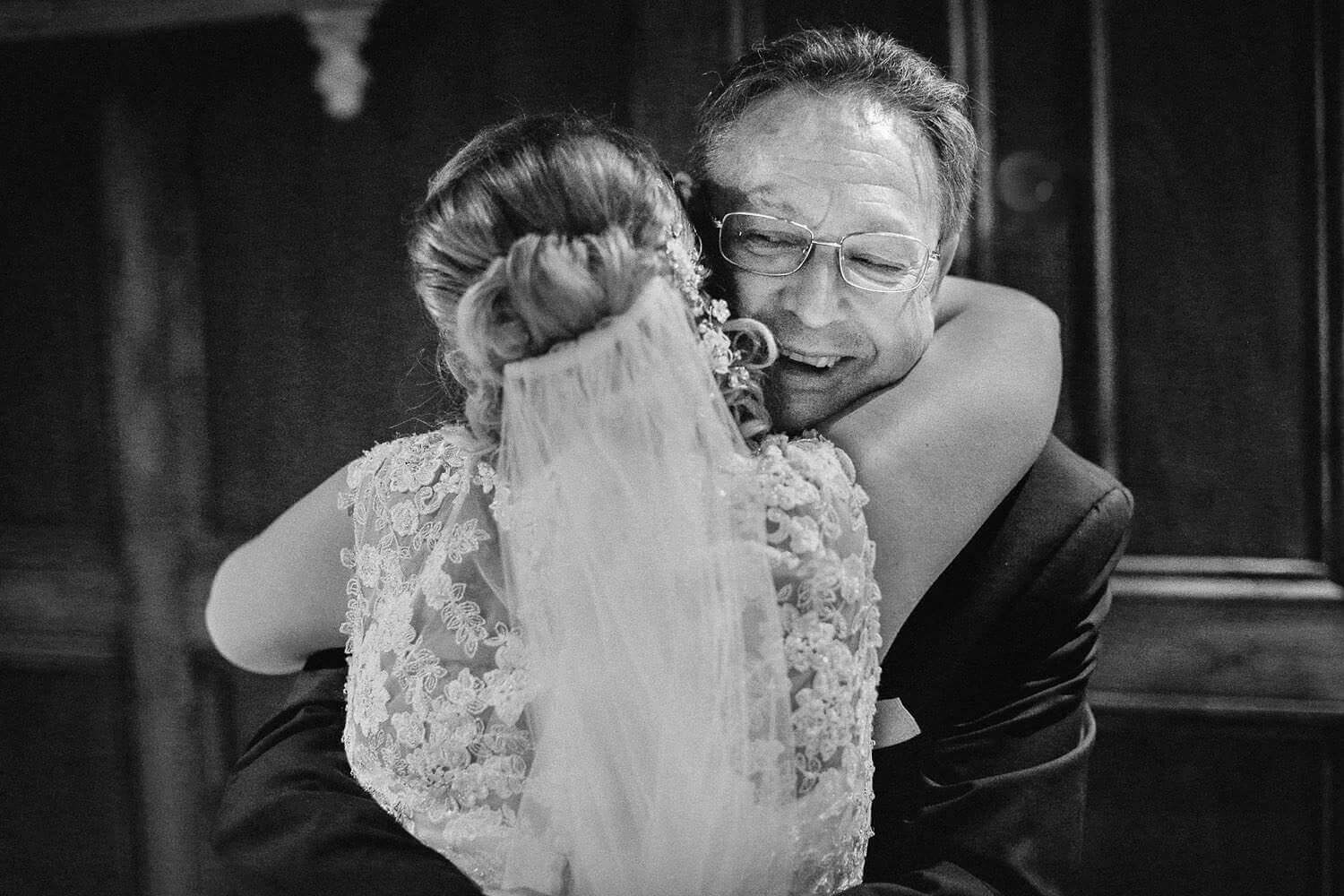 Dad hugging is daughter the bride on her wedding day in Liverpool