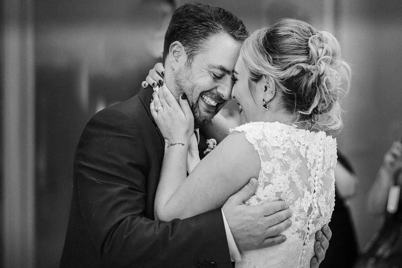 bride and groom hugging on dance floor at wedding