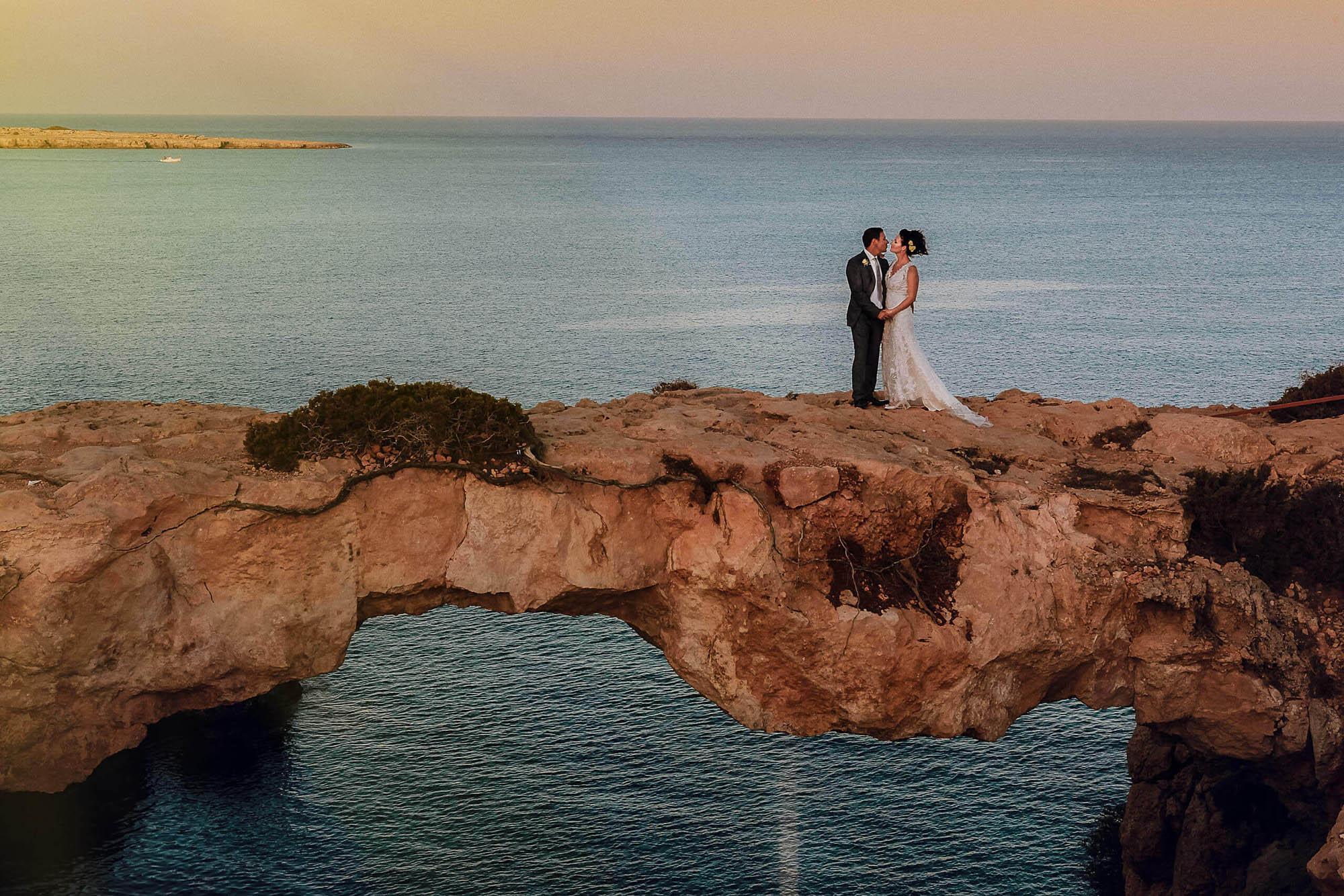 Cyprus-wedding-photographer-UK-bride-groom-standing-on-love-bridge