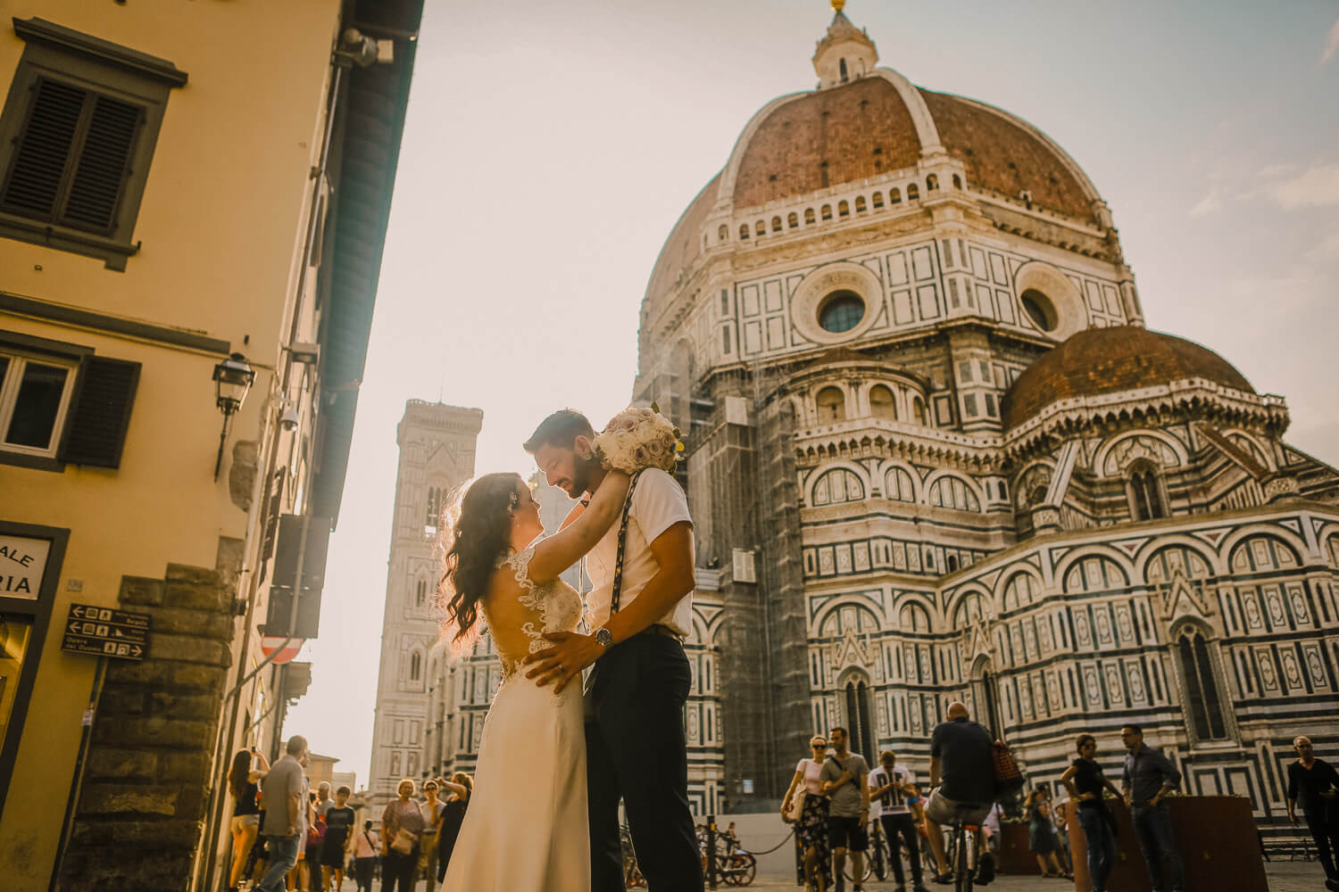 Bride and groom in front of Cathedral of Santa Maria Florence. Tuscany wedding photographer UK
