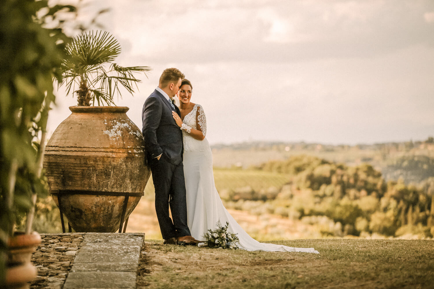 Bride and groom at sunset with big plant pot in Tuscany Hills