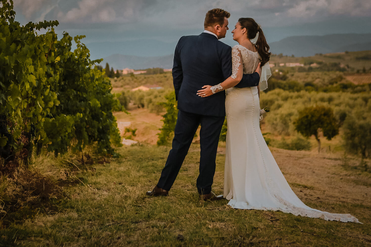 Wedding couples kissing in Tuscany vine yards in Chianti hills