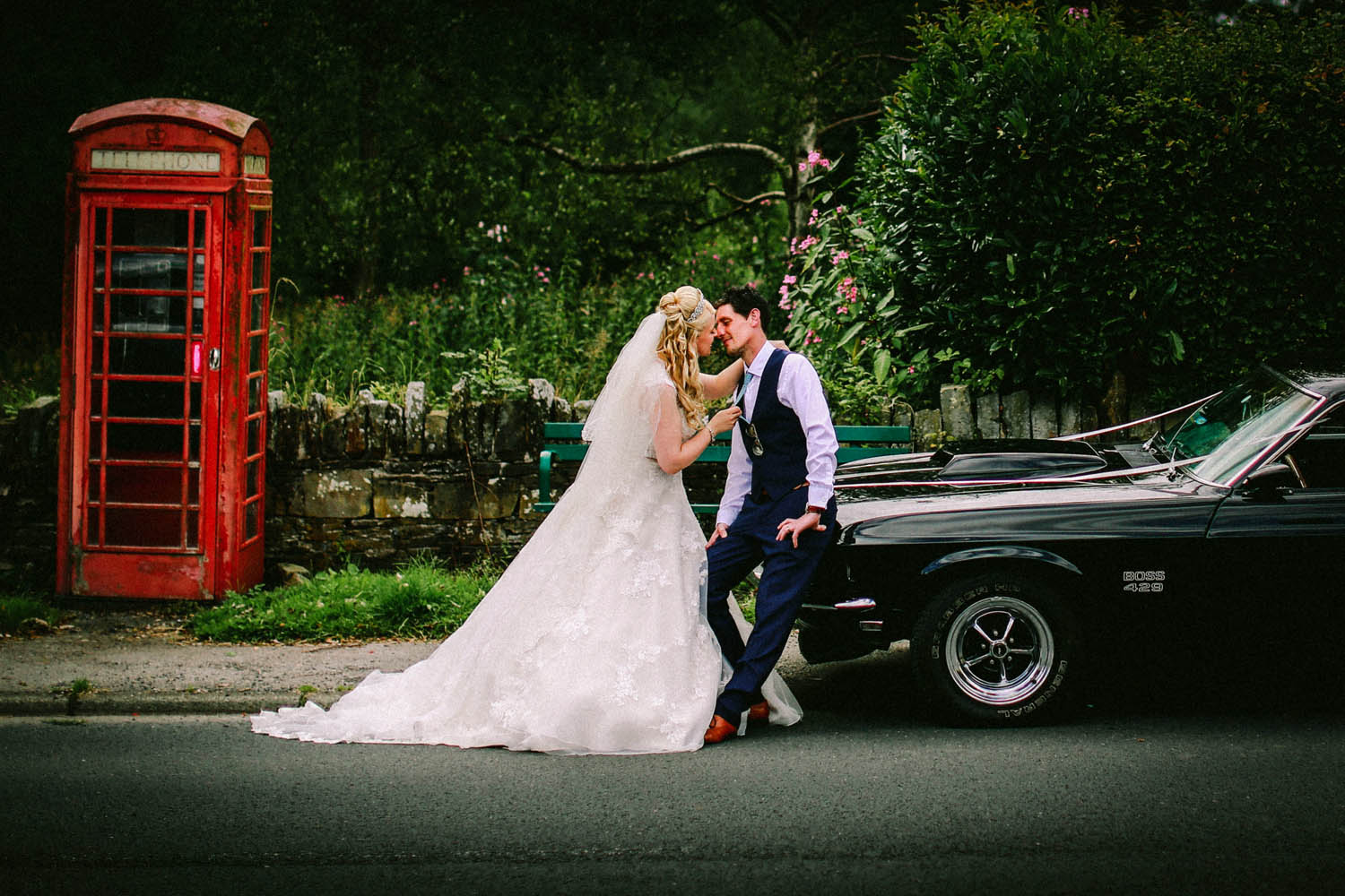Bride and groom old red phone box Ford Mustang MacDonald Kilhey Court wedding photographer Wes Simpson