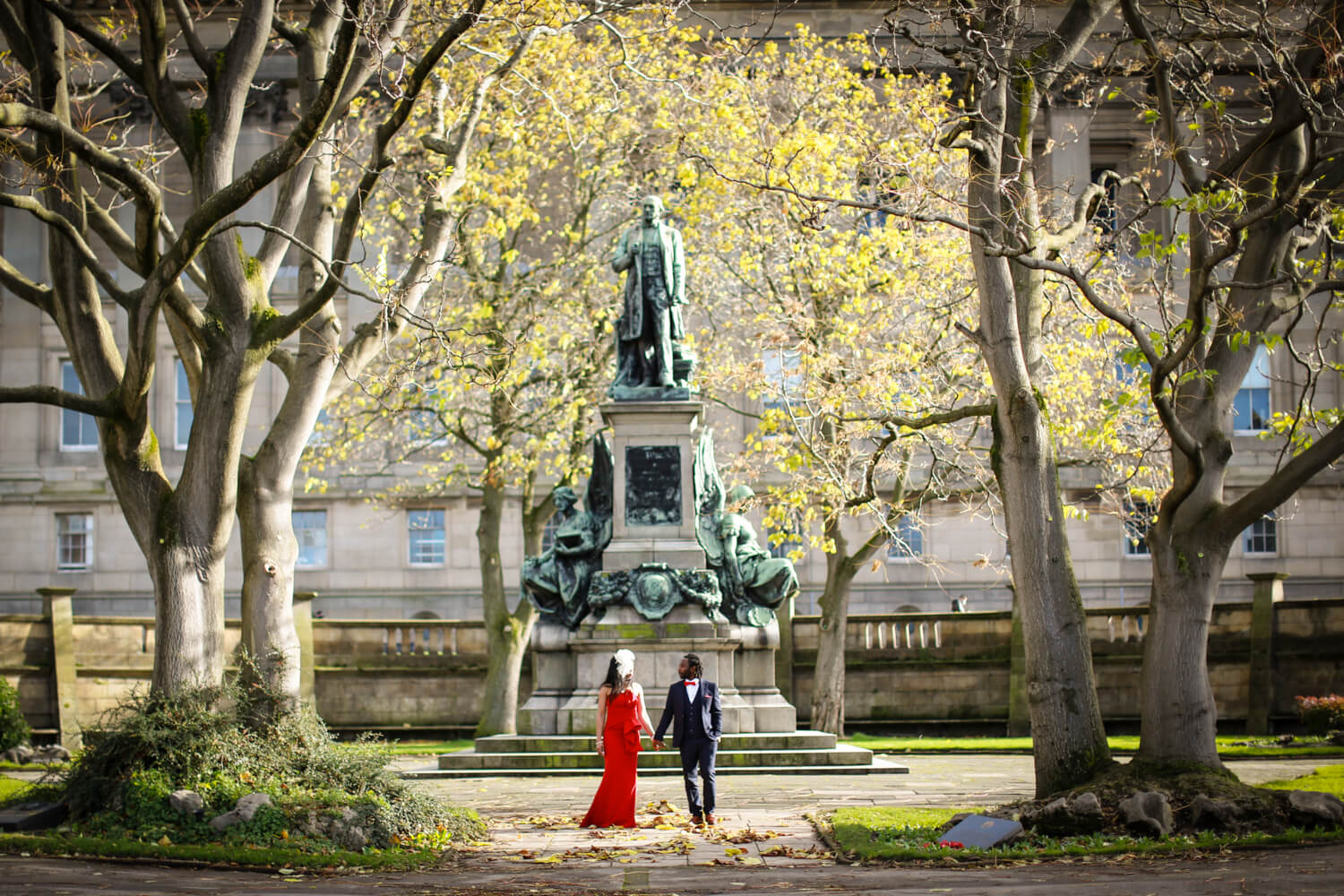 Covid wedding Liverpool Bride and groom walking through St George's gardens