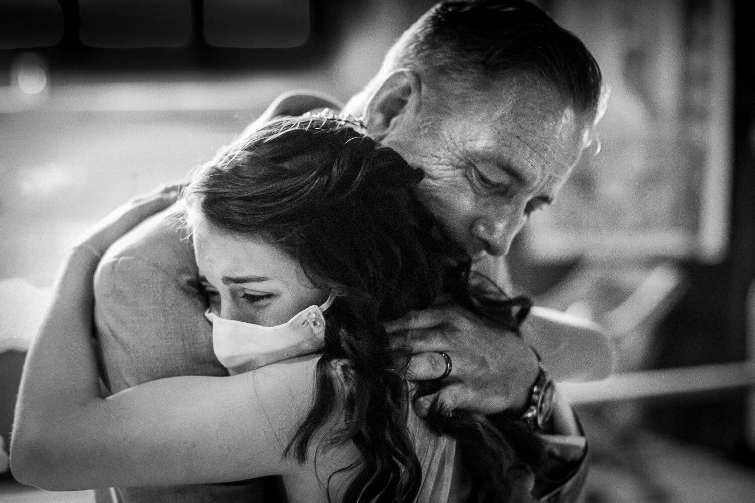 Father and daughter hugging at Covid wedding