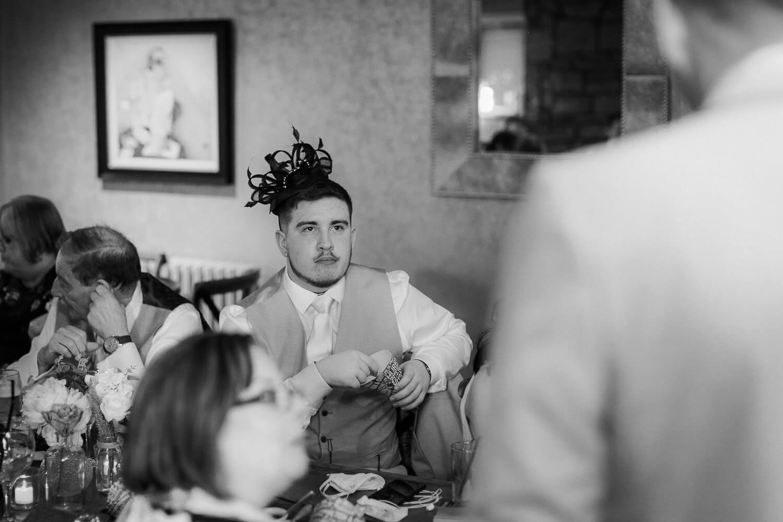 wedding guest wearing hat