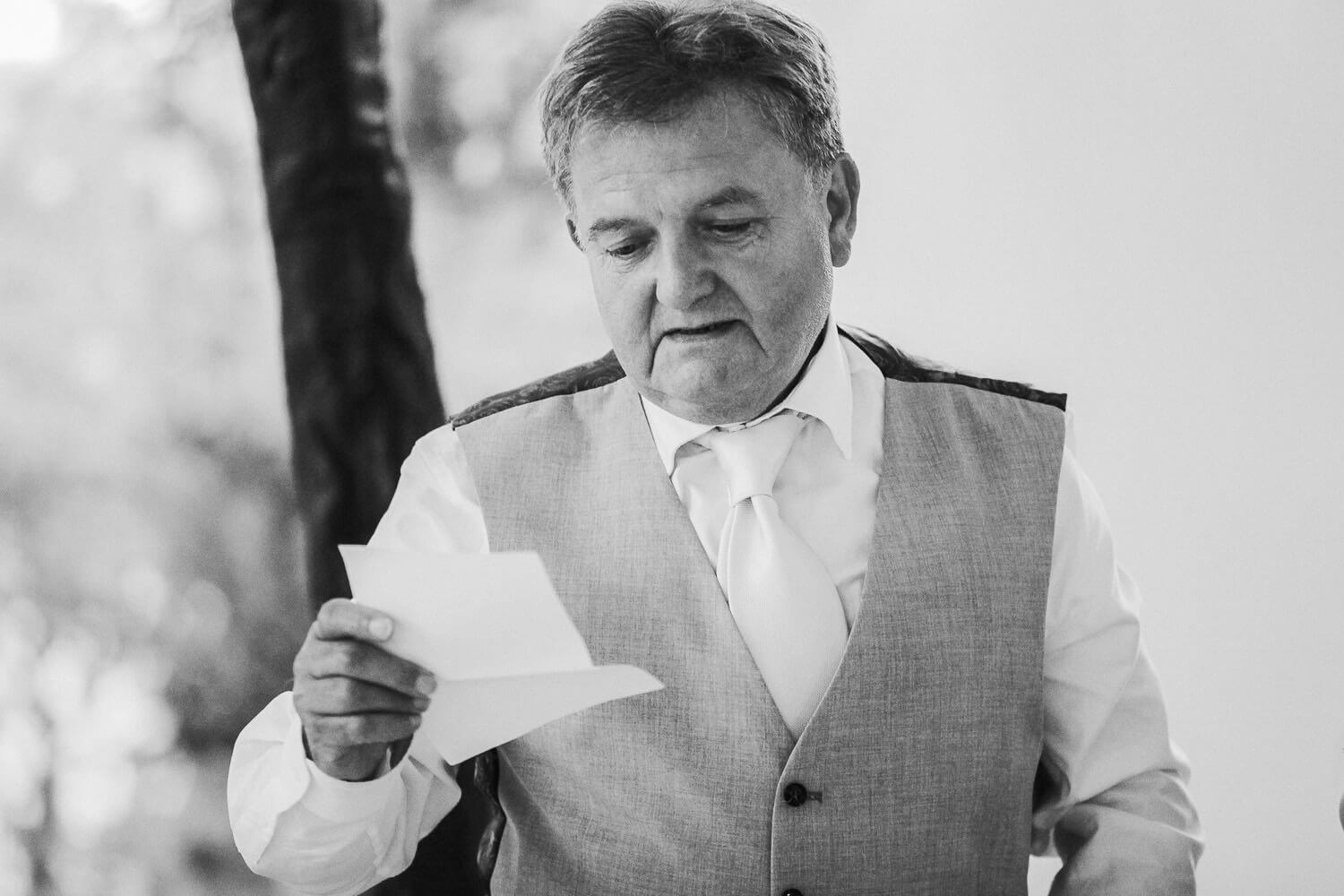 Man reading speech at wedding Covid wedding photography West Tower