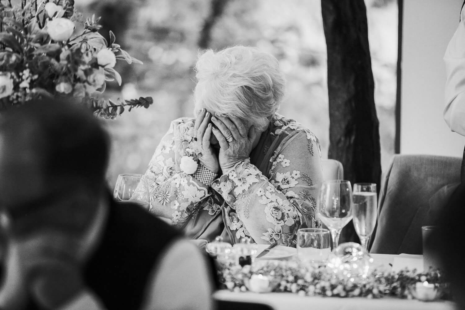 Woman hiding her face during speeches
