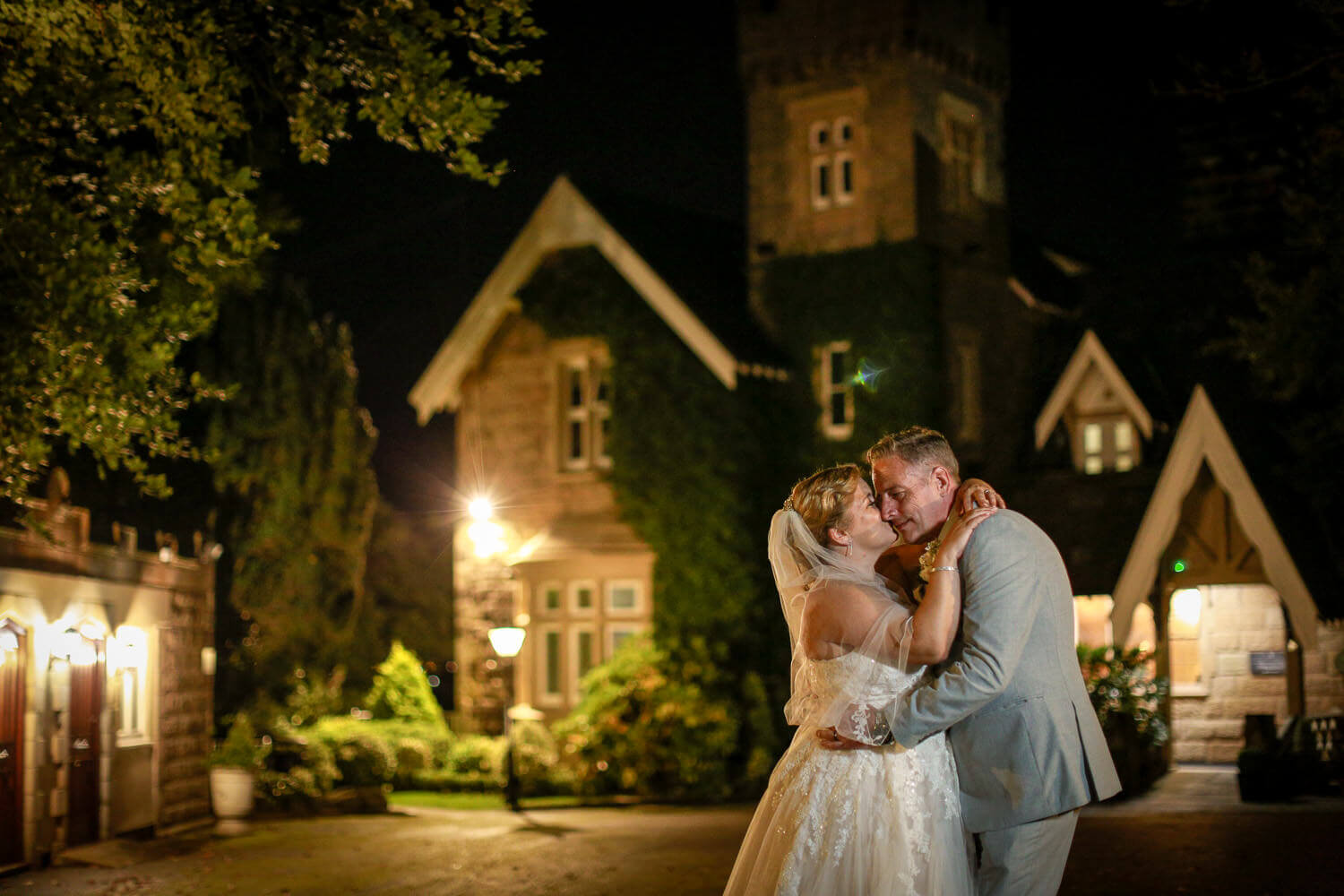Bride and groom at night West tower