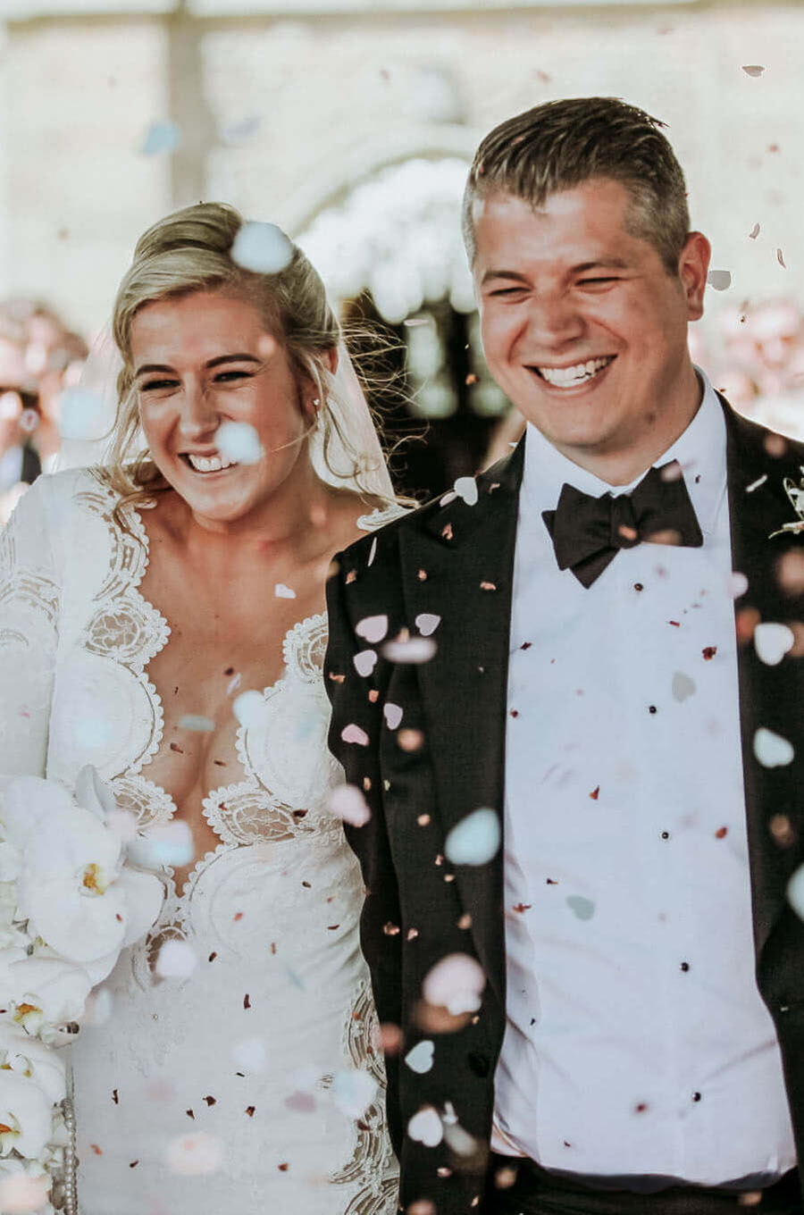 Wedding photographer Liverpool Wes Simpson. Happy bride and groom leaving church under confetti